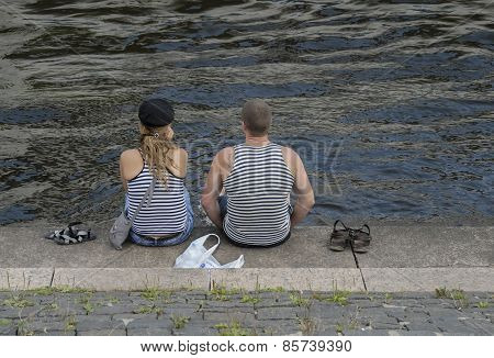 Young married couple are on the river bank
