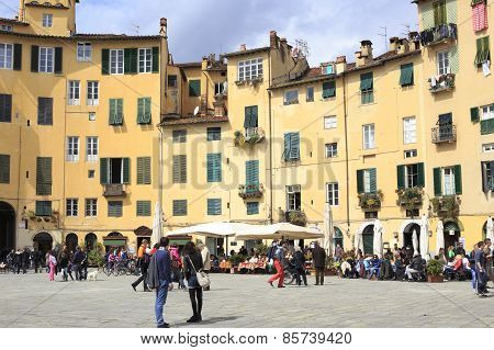 Tourists On Piazza Santa Maria In Lucca Italy
