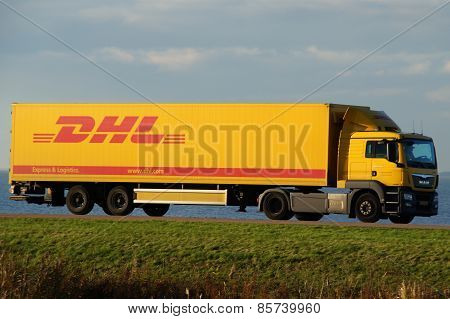 DHL delivery truck at dusk