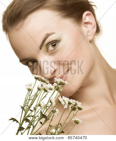 Beautiful young woman with gerber flower