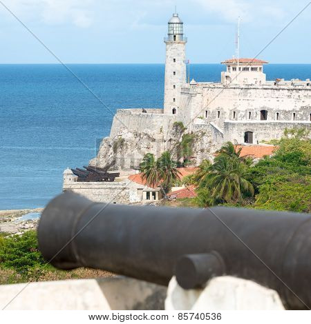 The fortress of El Morro in Havana with an old spanish cannon on the foreground