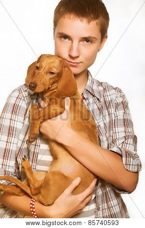 Young woman with a dachshund