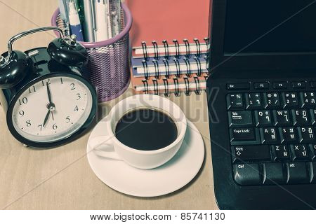 Black Coffee In White Cup And Alarm Clock On A Table