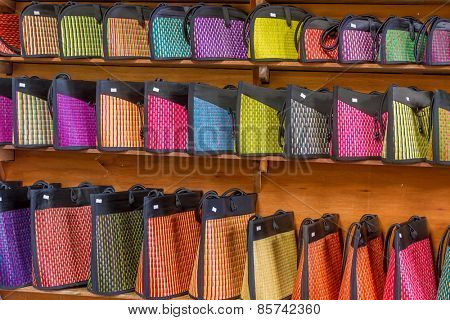traditional straw bags in souvenir shop
