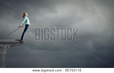 Young girl with ropes on hands trying to fly