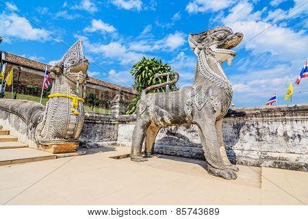 Singha And Naga Statue At Wat Prathat Lampang Luang Temple, Lampang, Thailand.