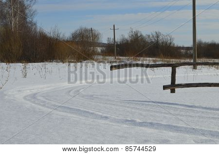 Field road and fence poles in rural areas