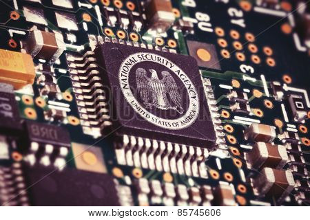 MARCH 16, 2015: Illustration of a spying CPU inside a computer with the NSA logo on it.