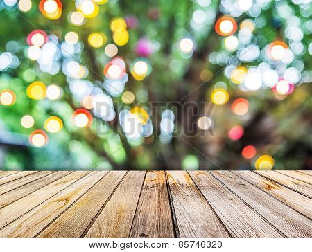 Perspective View To Lights Blurred Bokeh Of Big Tree Background And Wooden Floor Texture In The Even