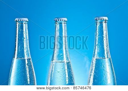 soda bottles with caps and water drops