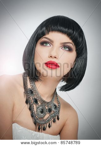 Hairstyle and Makeup - beautiful female art portrait with beautiful eyes. French style brunette