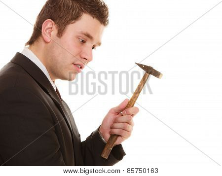 Pensive Business Man With Hammer