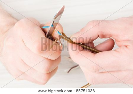 Removing insulation from copper wire