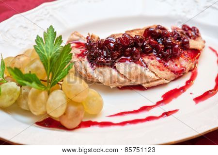 chicken breast meat with cranberry sauce