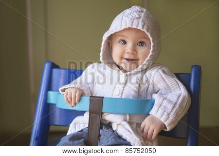 Beautiful Baby Girl In A Chair
