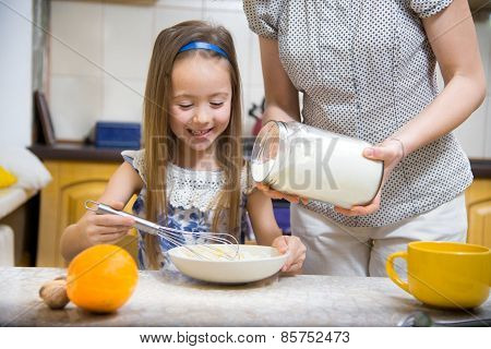 Small Girl Going To Beat The Dough For Pancakes
