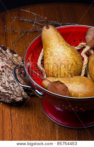 Pears On Red Colander