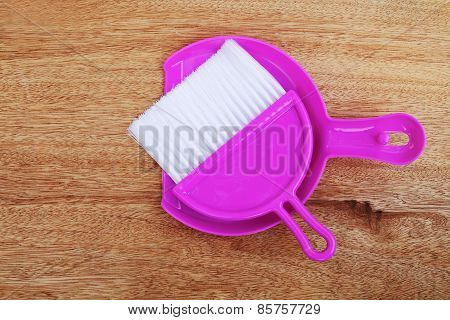 Pink Dustpan On Wooden Background