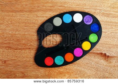 Watercolor Palette On Wooden Background