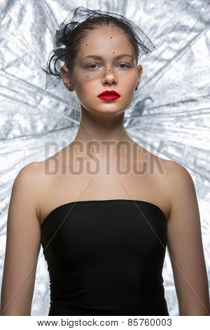 Attractive girl model with a veil on his face in black skin-tigh