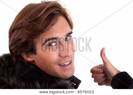 Portrait From Back Of A Young Man With Thumb Up, In Autumn/winter Clothes, Isolated On White. Studio