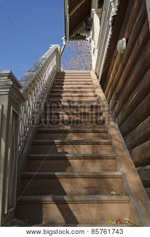 Long wooden staircase with carved railings
