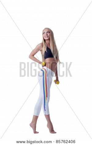 Beautiful sporty girl posing with dumbbells