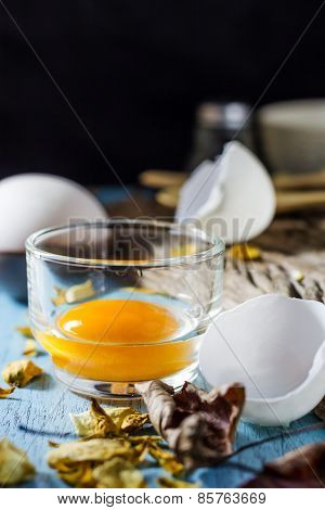 Still Life Broken White Eggs And Egg Yolk On A Wooden Rustic Background