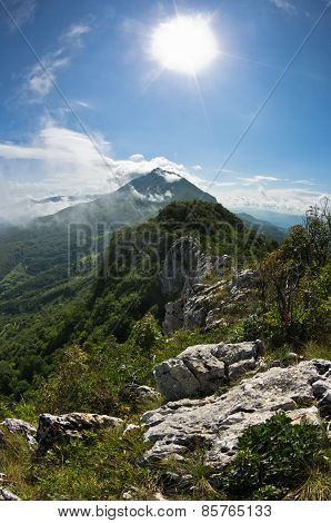 Mountain peaks of Suva Planina at sunny morning covered with clouds