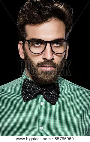 Handsome Bearded Man In Glasses And Bow Tie