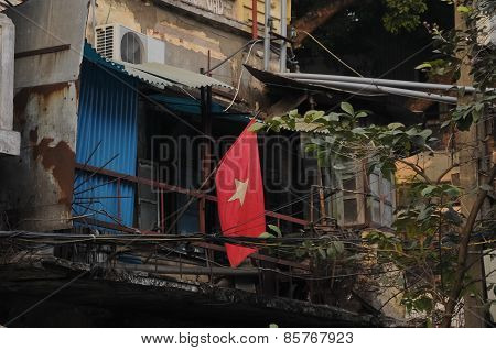 Vietnam National Flag And Old Poor Townhouse