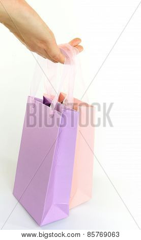 Hand Holding Colorful Shopping Bags Isolated On White