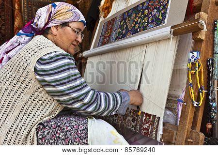 Hand knotting an Oriental carpet.