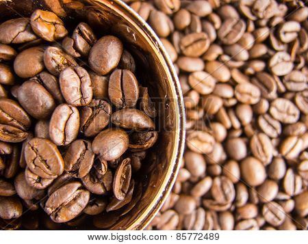 Coffee beans and coffee cup view from above