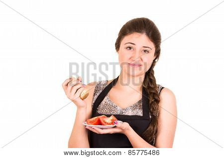 beautiful young girl eating fresh tomatoes