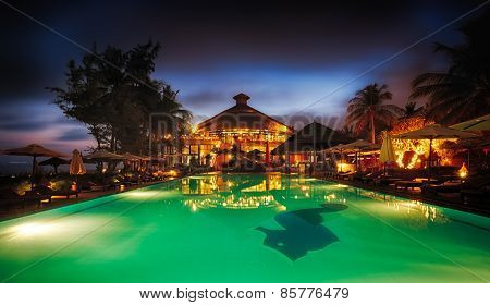 MUI NE, VIETNAM - FEBRUARY 07, 2014: Pool of a seaside resort in Mui Ne at dusk