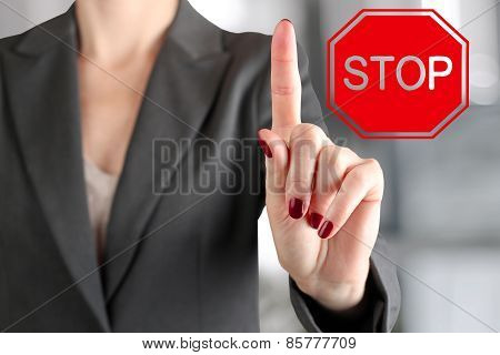 Businesswoman Lifting  A Finger Up.  Paying Attention Gesture