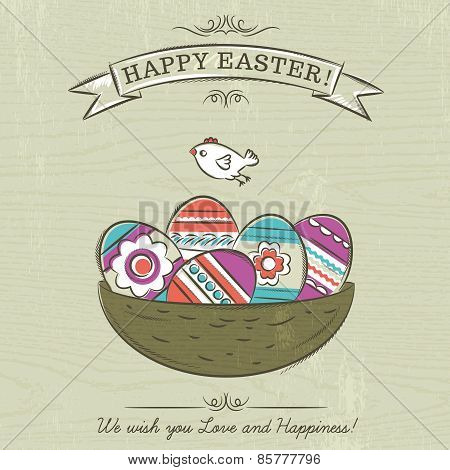 Beige Background With Nest Full Of Easter Eggs, Ribbon With The Inscription Happy Easter And One Bir