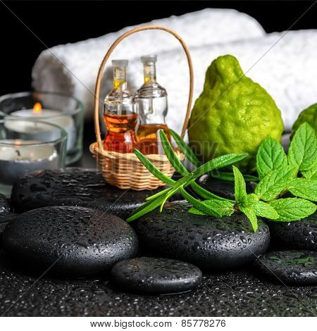 Aromatic Spa Still Life Of Bottles Essential Oil, Fresh Mint, Rosemary, Bergamot Fruits, Towels And