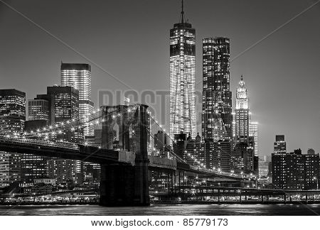 New York By Night. Brooklyn Bridge, Lower Manhattan - Black And White