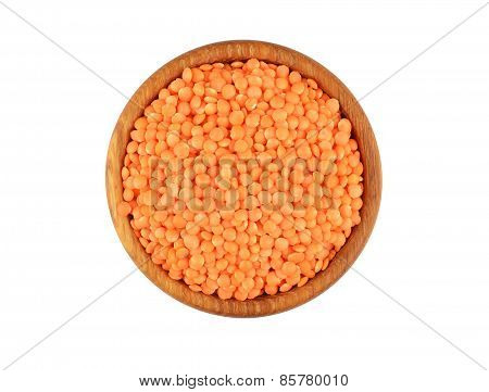 Red lentil in wooden bowl