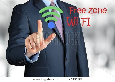 Bisinessman  In  A Modern Suit Touching  A sign Of Wi-fi