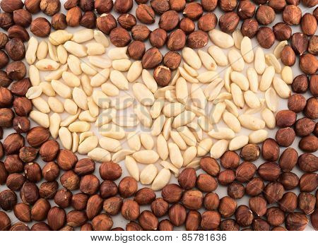 Heart shape made of peanuts and hazelnuts