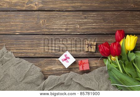 Gift Boxes And Fabric Near Tulips