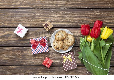 Cookies And Gift Boxes Near Tulips