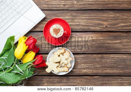 Cup Of Cappuccino With Heart Shape And Computer