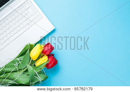 Computer With Bouquet Of Tulips