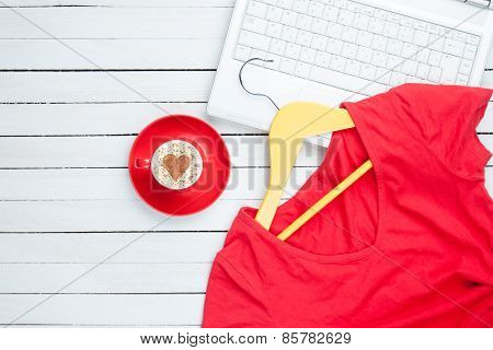 Cup Of Cappuccino With Heart Shape And Computer With Hanger