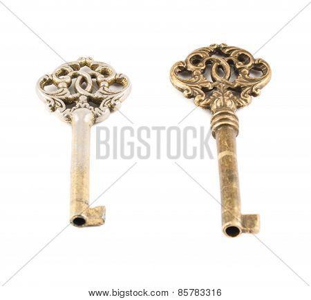 Old decorative metal keys isolated