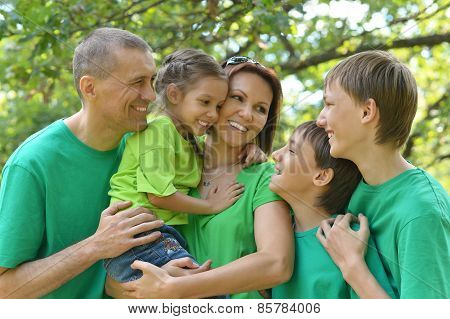 family in green shirts